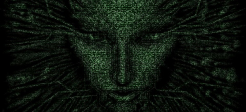 A landscape image of Shodan, a feminine face made up of green digital characters against a black background.